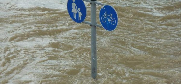 Street sign showing above flood waters